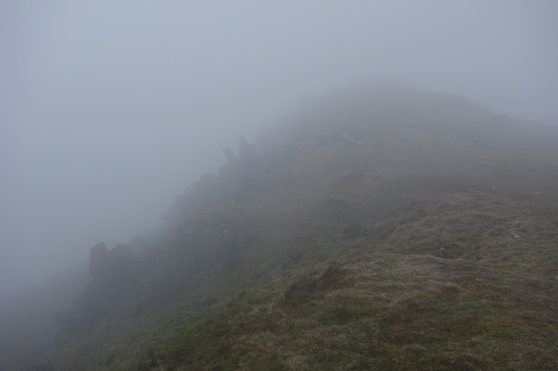 Skirting the edge in mist between Cadair Berwyn and Moel ych