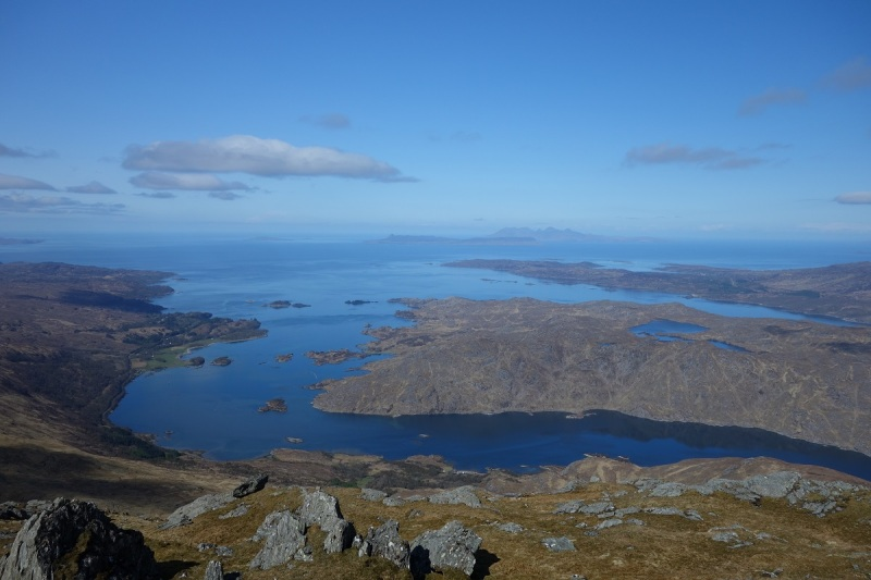 Looking West from the top of An Stac out towards Eigg and Rum